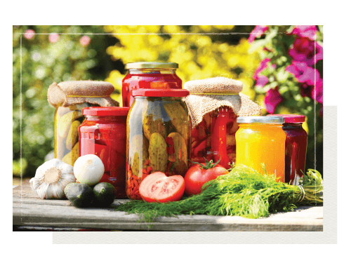 Cans and jars of garden vegetables